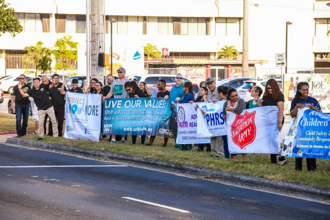 Social service providers and other supporters take part in an awareness wave in celebration of Sexual Assault Awareness Month and Child Abuse Prevention Month along Marine Corps Drive, opposite the Chamorro Village in Hagåtña, on Wednesday, April 10, 2019.