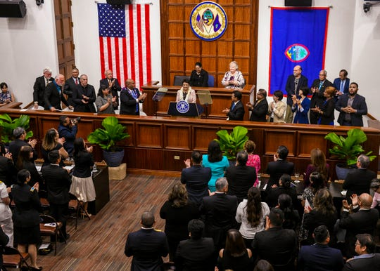 Gov. Lou Leon Guerrero is given a standing ovation after her delivery of the State of the Island Address in the Session Hall of the Guam Congress Building on Thursday, April 11, 2019.
