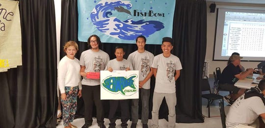 Okkodo's Team Alileng, participated for their first time in the Fish Bowl competition on March 30. Pictured: Geraldine Nucum; advisor, William De Leon Guerrero, Colin Bamba, Christopher Nauta, and Danny Taguiam. The Fish Bowl Competition is an annual Island-wide Marine Biology Competition open all high schools with questions focused on Marine Biology.