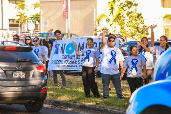 An awareness wave held to mark Sexual Assault Awareness Month and Child Abuse Prevention Month along Marine Corps Drive in this April 10, 2019, file photo.