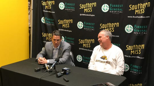 From left, incoming Southern Miss Athletic Director Jeremy McClain and basketball coach Doc Sadler talk about Sadler's resignation during a news conference Thursday, April 11, 2019, at Reed Green Coliseum.