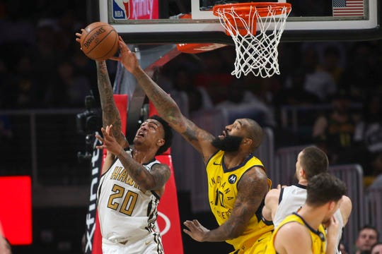 Apr 10, 2019; Atlanta, GA, USA; Atlanta Hawks forward John Collins (20) is blocked by Indiana Pacers center Kyle O'Quinn (10) in the second quarter at State Farm Arena.