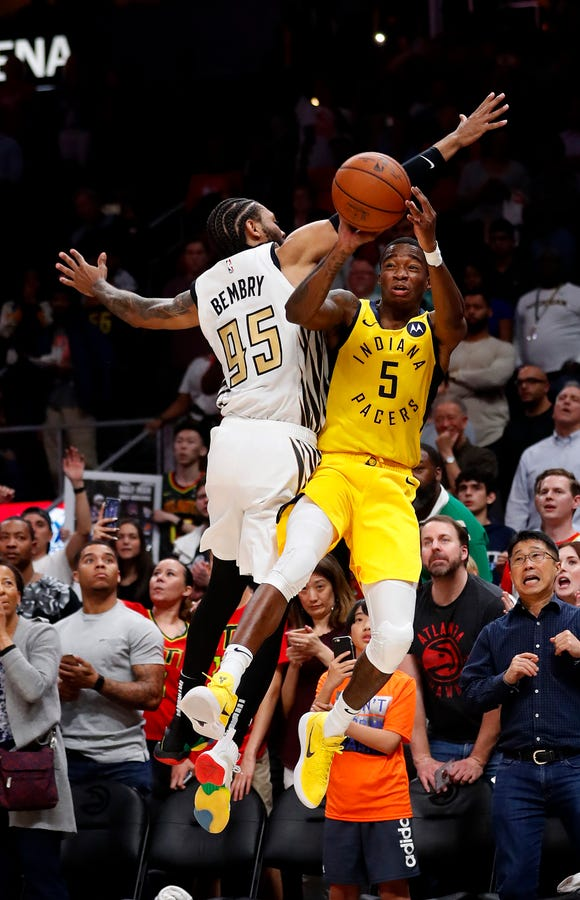 Indiana Pacers guard Edmond Sumner (5) is fouled by Atlanta Hawks forward DeAndre' Bembry (95) as he shoots in the final seconds of an NBA game basketball Wednesday, April 10, 2019, in Atlanta. Sumner made all three free throws to give the Pacers a 135-134 victory.