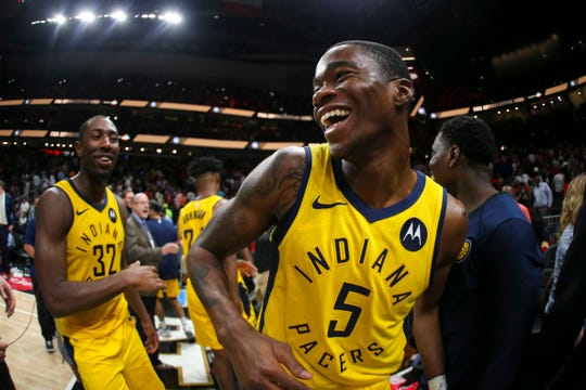 Apr 10, 2019; Atlanta, GA, USA; Indiana Pacers guard Edmond Sumner (5) celebrates a victory against the Atlanta Hawks at State Farm Arena.