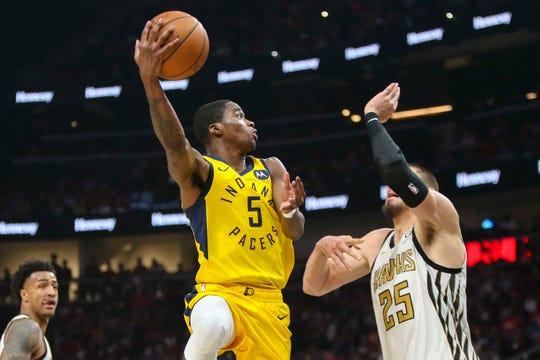 Apr 10, 2019; Atlanta, GA, USA; Indiana Pacers guard Edmond Sumner (5) shoots against the Atlanta Hawks in the second quarter at State Farm Arena.