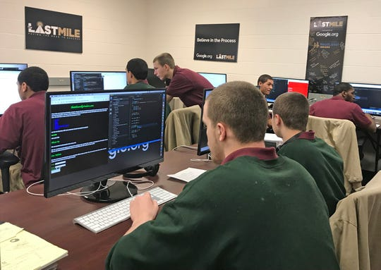 Keith Stallings and Jonah Wallsmith work on projects in their computer coding class at the Pendleton Juvenile Correctional Facility in March.
