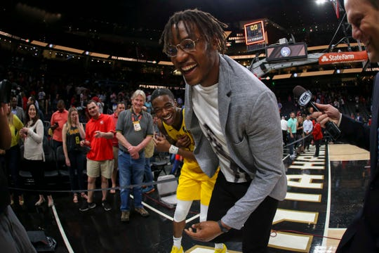 Apr 10, 2019; Atlanta, GA, USA; Indiana Pacers center Myles Turner (33) and guard Edmond Sumner (5) celebrate a victory against the Atlanta Hawks at State Farm Arena.