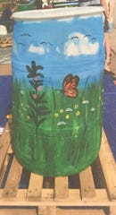 Don't like the look of your utilitarian rain barrel? Find your inner artist and spruce it up a bit.