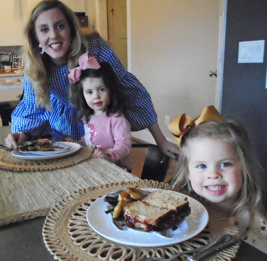 Ashley Bermel of North Liberty, shown here with daughters Evie (left) and Wynnie, will be among those taking part in the city's Placemates program on June 20, where local families will be matched with new friends at small potluck dinners hosted in private homes.  She and her husband, Jesse, recently moved here from Chicago.
