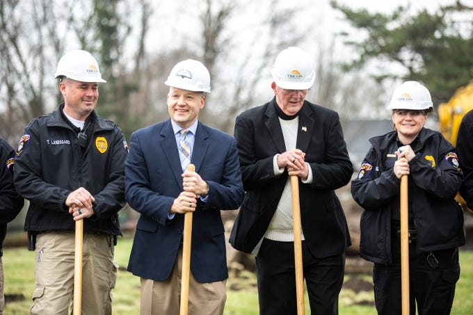 North Liberty Police Lt. Tyson Landsgard, city administrator Ryan Heiar, Mayor Terry Donahue and Police Chief Diane Venenga stand with shovels during a ground breaking for a new police station on Thursday, April 11, 2019, along Cherry Street in North Liberty, Iowa.