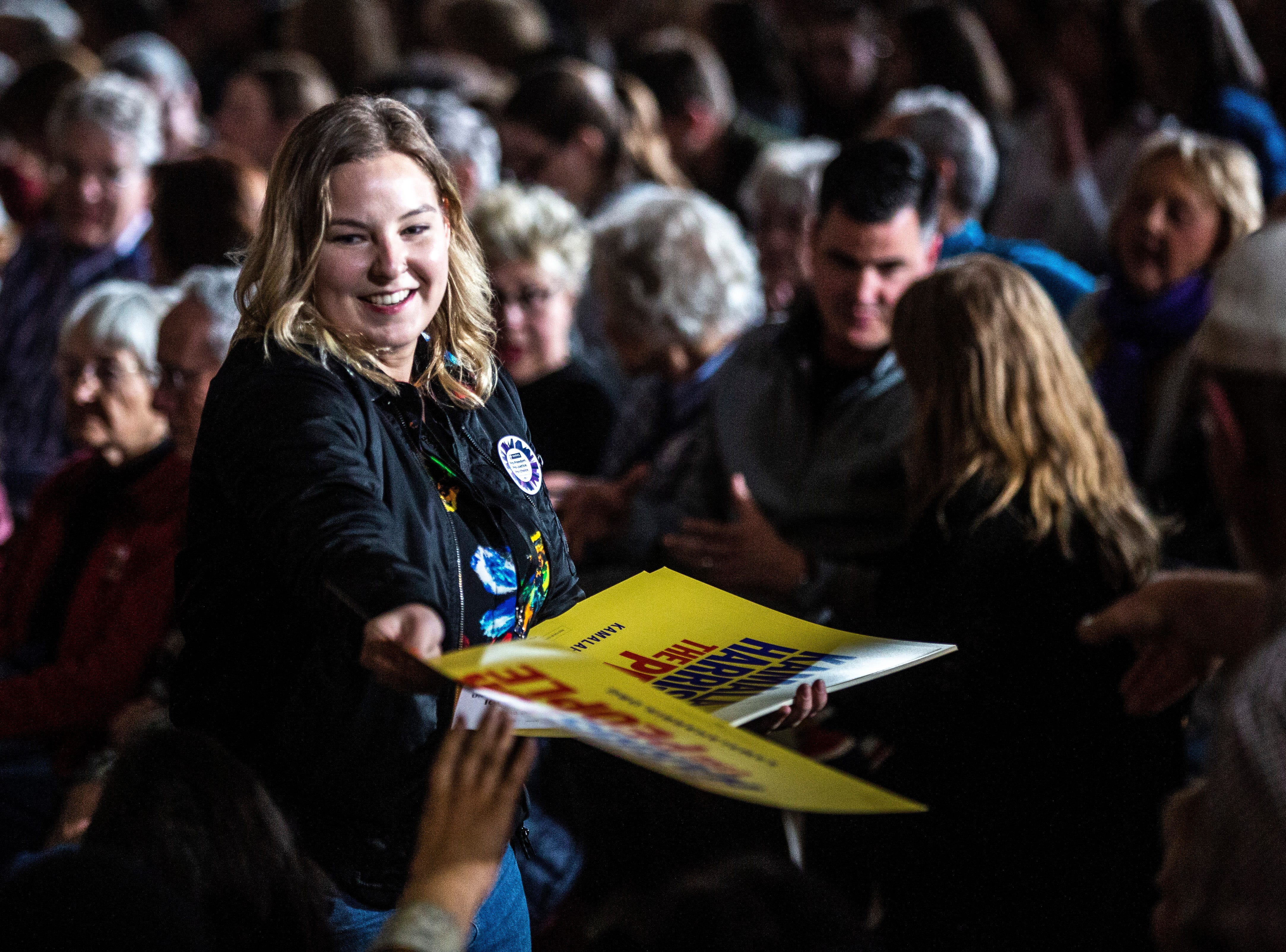 Volunteers hand out signs for U.S. Sen. Kamala Harris, D-Calif., before a town hall event on Wednesday, April 10, 2019, at the Iowa Memorial Union main lounge in Iowa City, Iowa.