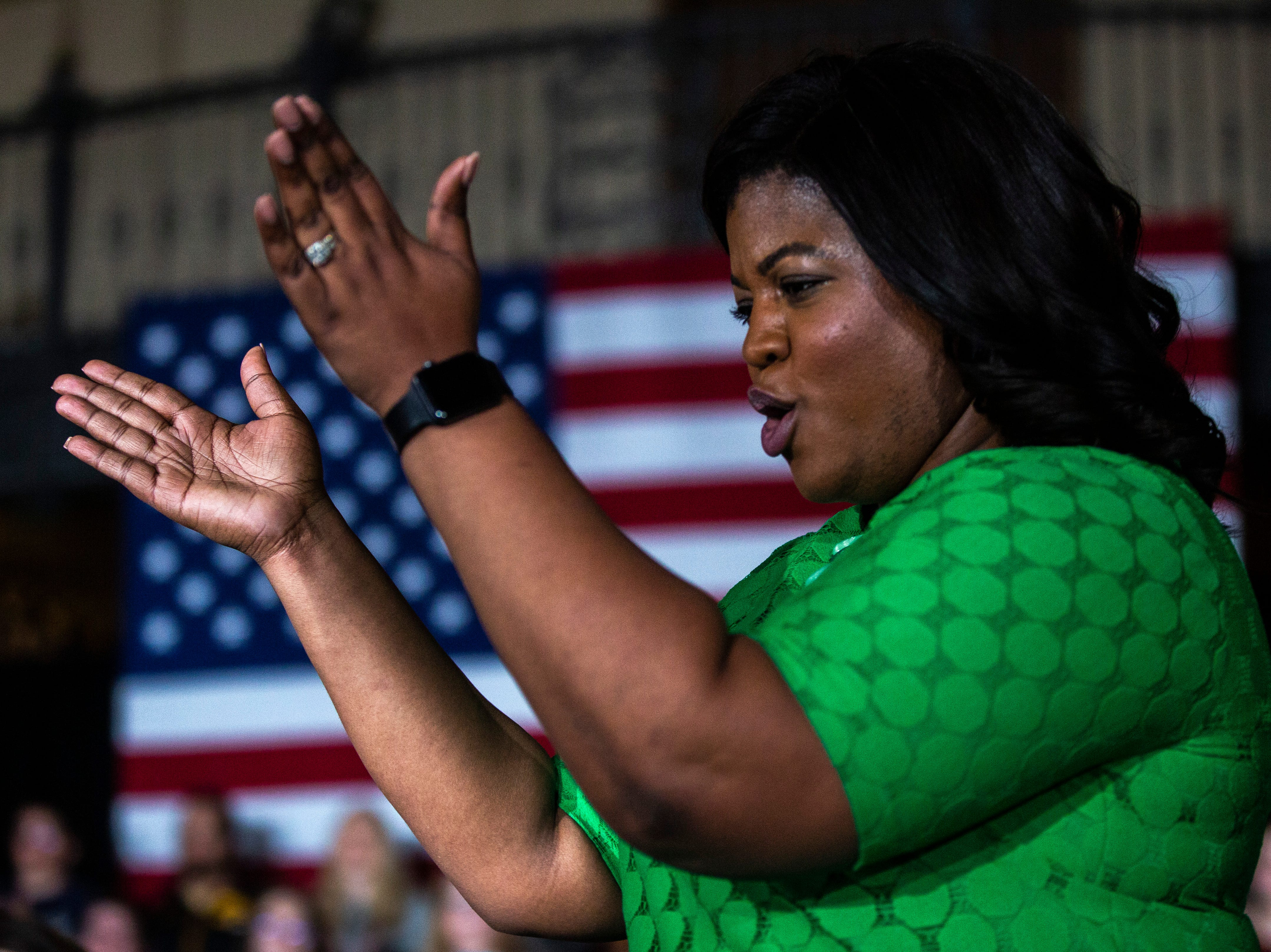 Deidre DeJear claps while walking up on stage during a town hall event on Wednesday, April 10, 2019, at the Iowa Memorial Union main lounge in Iowa City, Iowa.