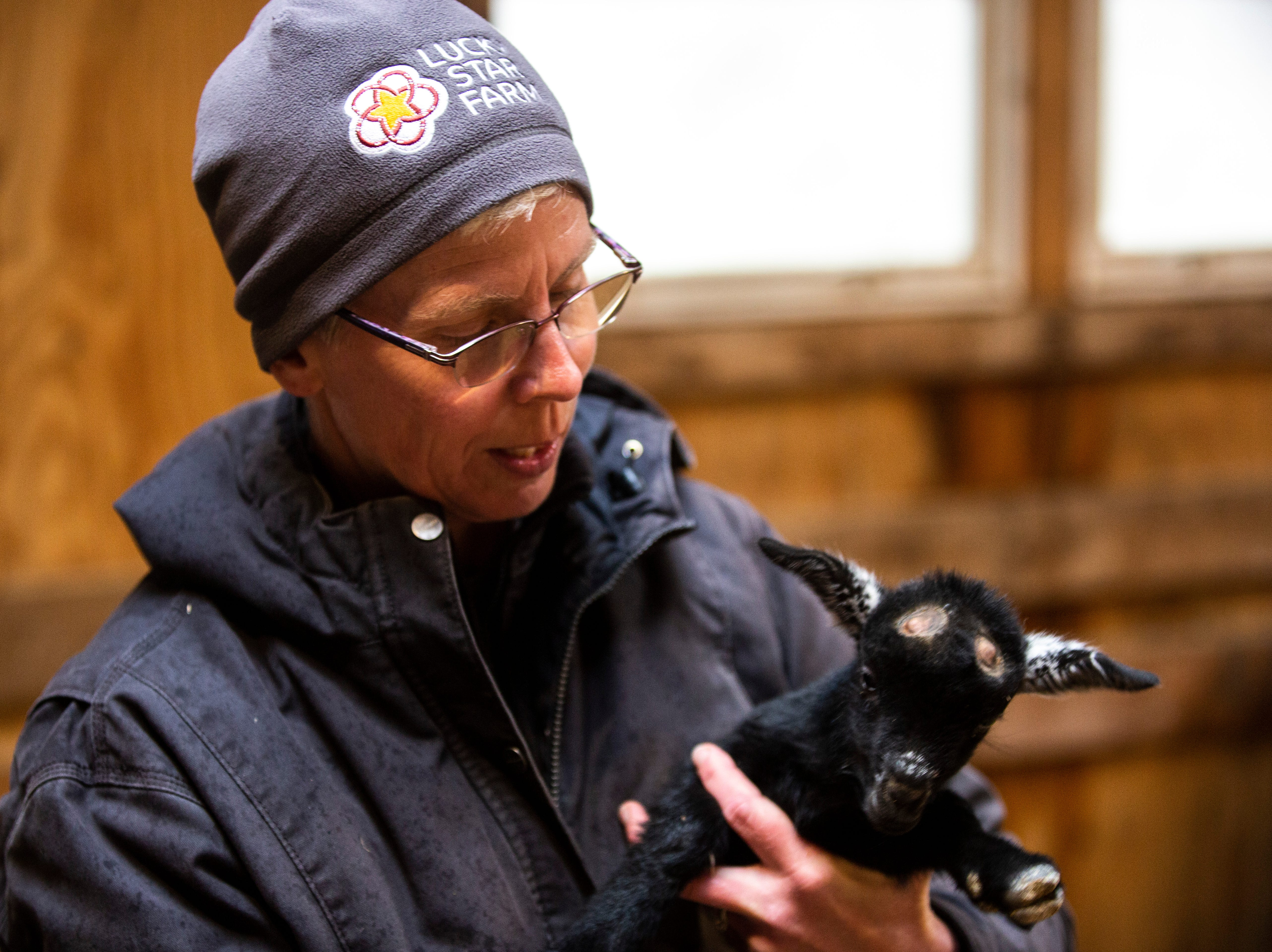 Susan Young feeds Rizzo, a young goat, on Thursday, April 11, 2019, at Lucky Star Farm in Iowa City, Iowa.