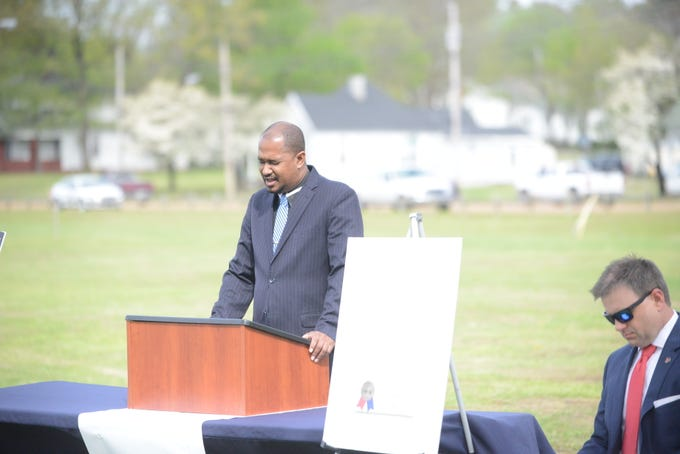 Pastor Terrance Miller delivers the invocation before starting the ceremony.