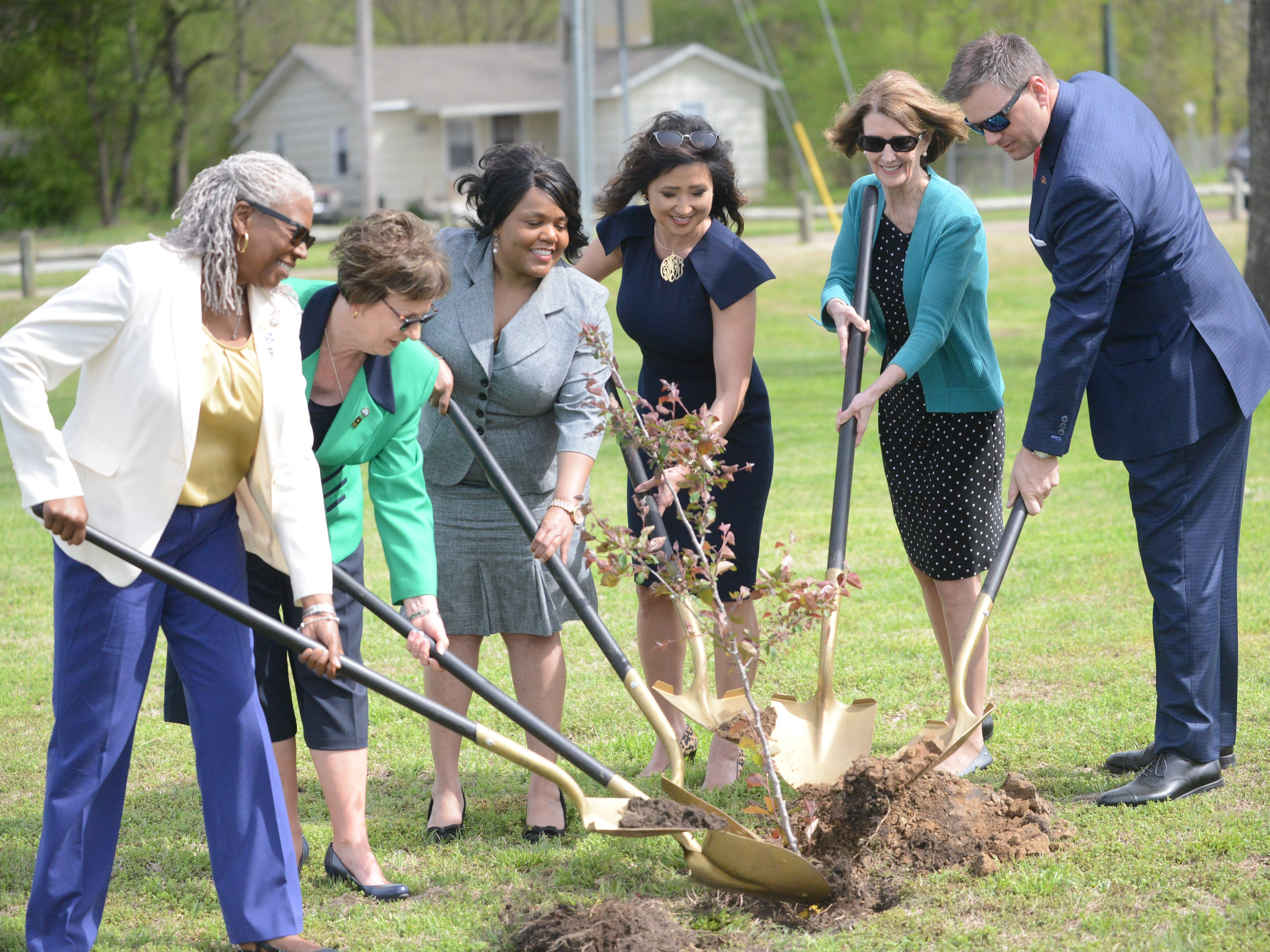 Maryetta Rudd, Nancy Richardson, Christina Gold, Keli McAlister, Jane Jarvis and Barrett Rich plant a tree in honor of crime victims at Shirlene Mercer Walking Trail in Jackson.