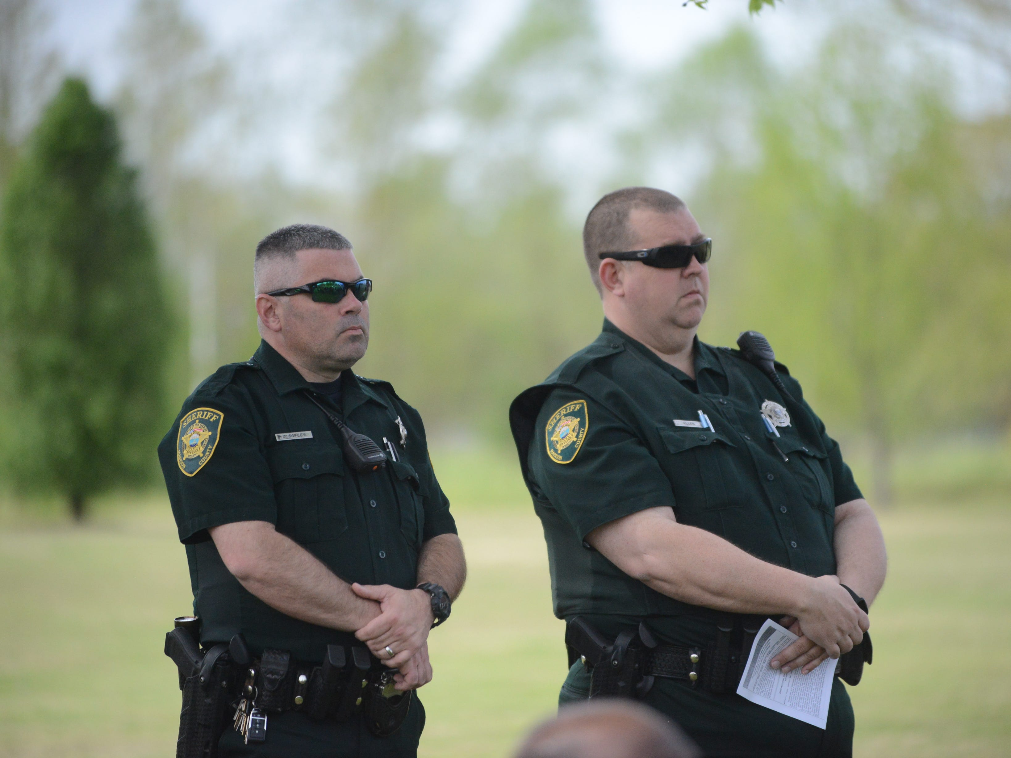 Two Madison County Sheriff deputies watch the ceremony unfold.
