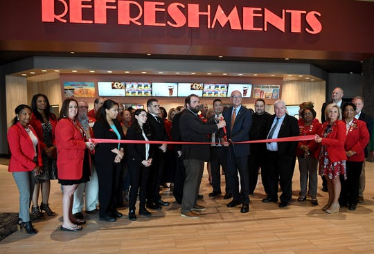 Members of the Jackson Chamber gathered at Empire 8 movie theater Thursday, April 11, for a ribbon-cutting ceremony.