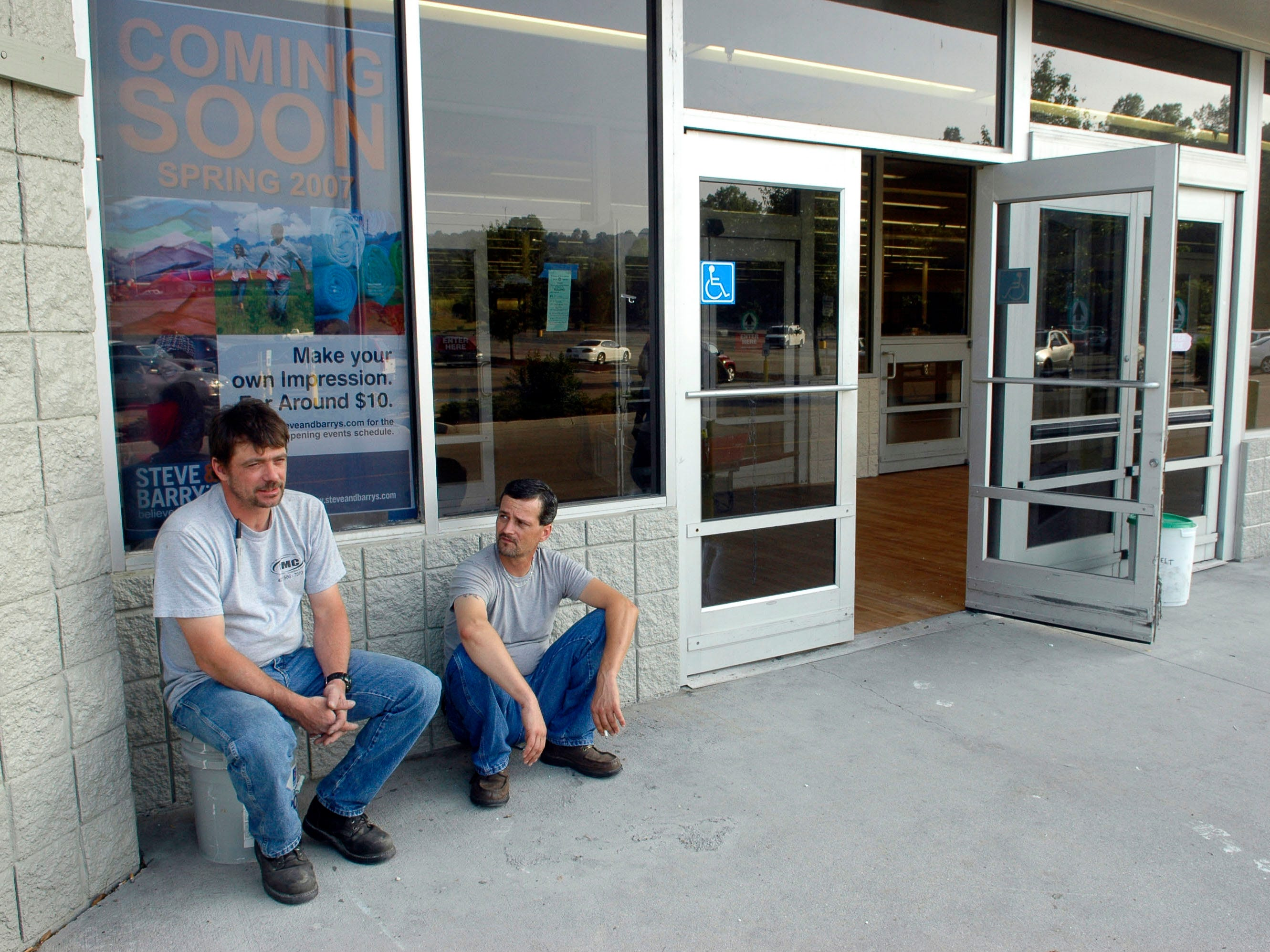 Workers take a break out side on Thursday  June 14, 2007 at the retail location where Steve & Barry's will occupy when renovations are complete. National discount clothing retailer Steve & Barry's will open a 68,000-square-foot location the the former Wal-mart site on the Chapman-Ford Crossing shopping center.