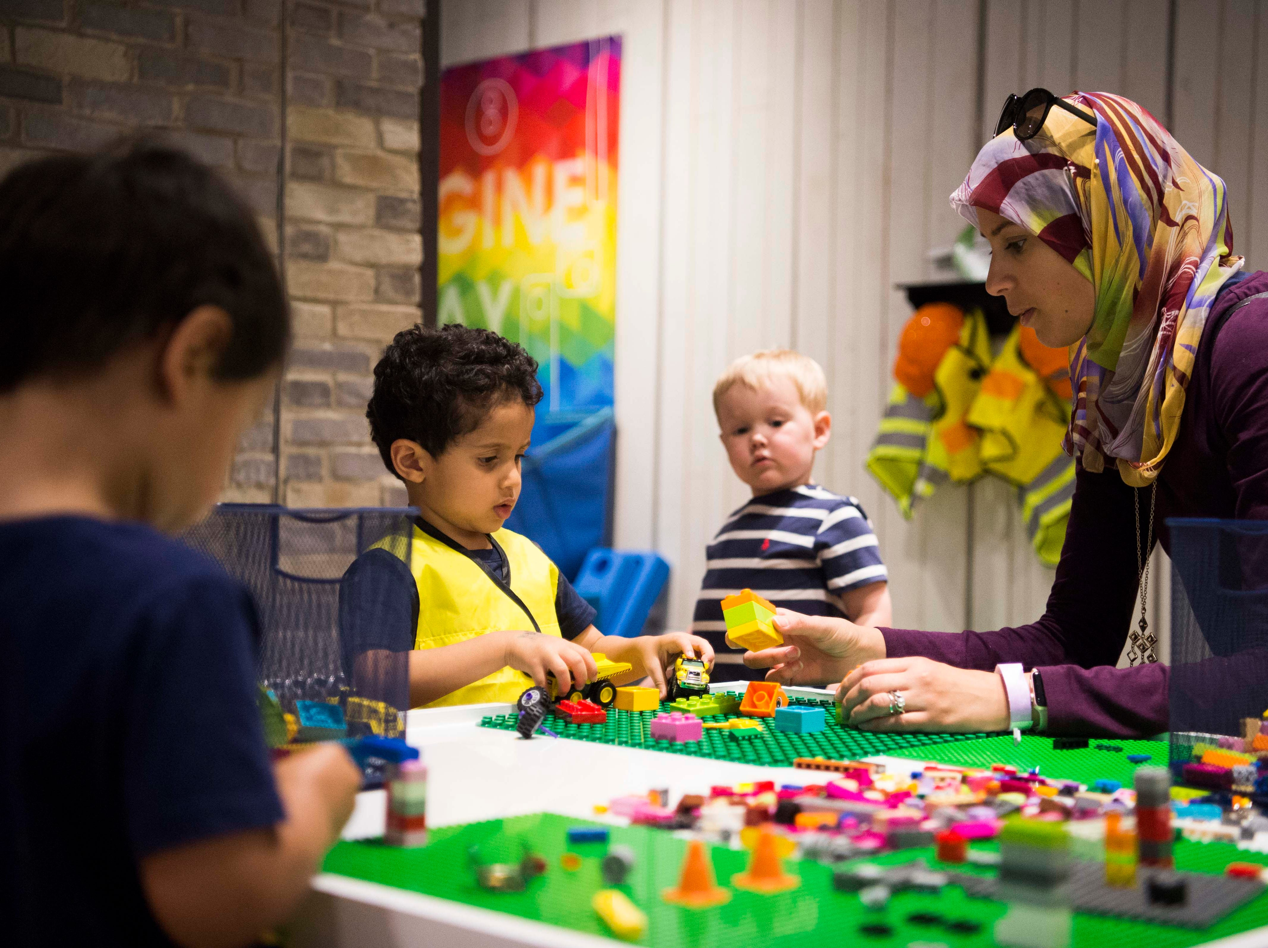 At right Rahma Ismail plays with Amin Alsharif at the new Muse at the Mall at West Town Mall in Knoxville Thursday, April 11, 2019. The Muse offers STEAM (science, technology, engineering, art, math) based play for Knoxville families, and will open to the public on Saturday April 13.