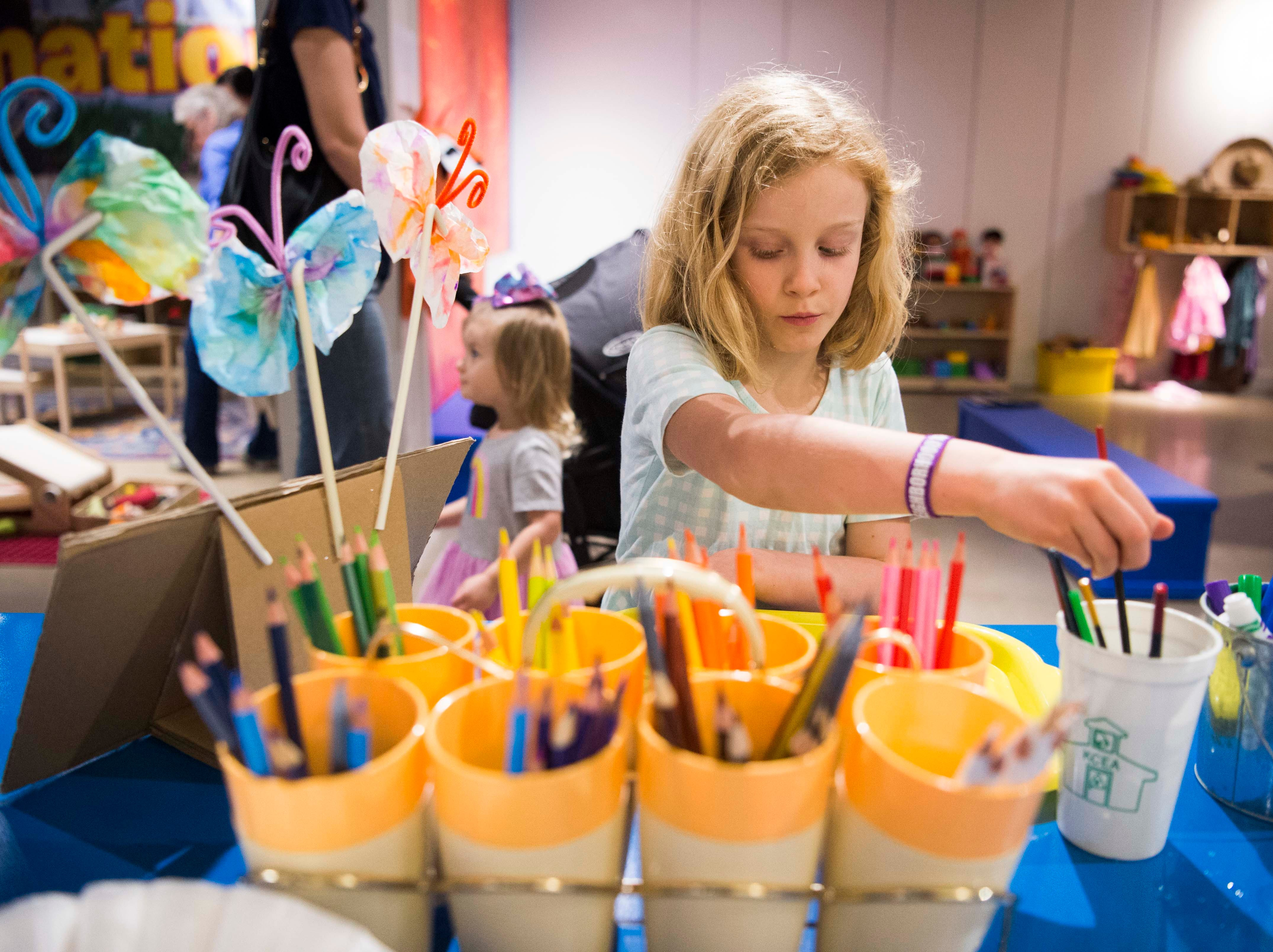 Ellie Sams, 7, of Knoxville makes a coffee filter butterfly at the new Muse at the Mall at West Town Mall in Knoxville Thursday, April 11, 2019. The Muse offers STEAM (science, technology, engineering, art, math) based play for Knoxville families, and will open to the public on Saturday April 13.