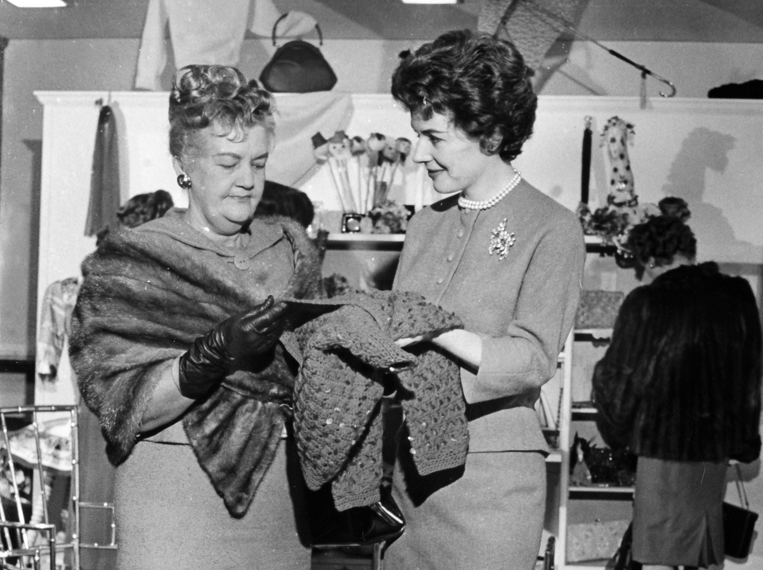 Polly Bergen shows Mrs. Clyde Brownsey, 4411 Exemouth Drive, a jeweled sweater on Nov. 30, 1959, at the opening of Bergen's new shop, Polly Bergen's Fashions of the Four Seasons, 6113 Chapman Highway.