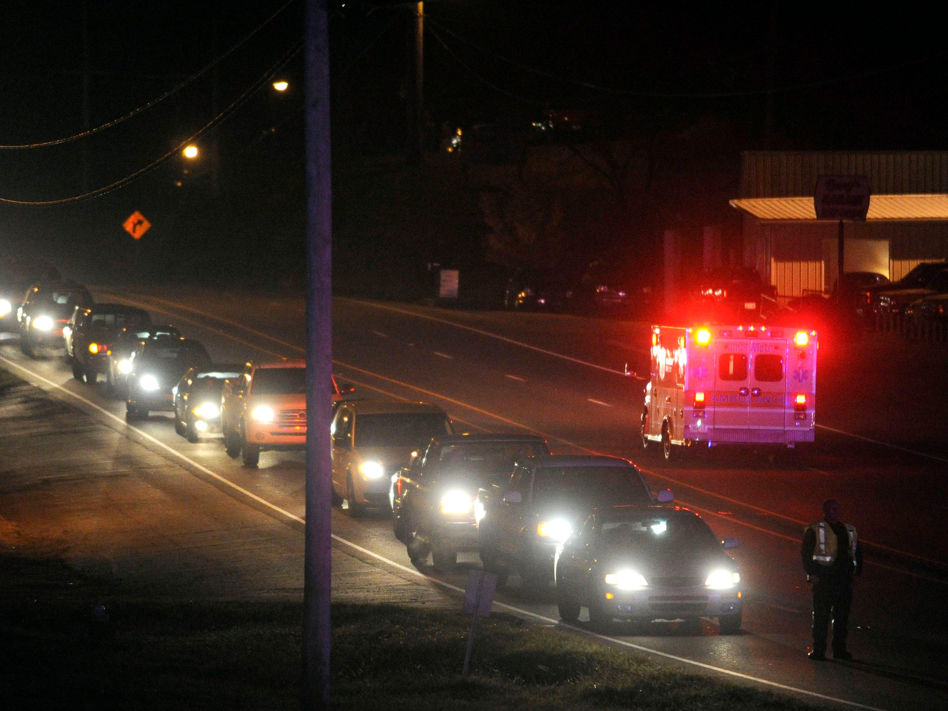 An ambulance leaves the Chatterbox Tavern in south Knox County as traffic backs up on Chapman Highway on Thursday, Nov. 13, 2014.