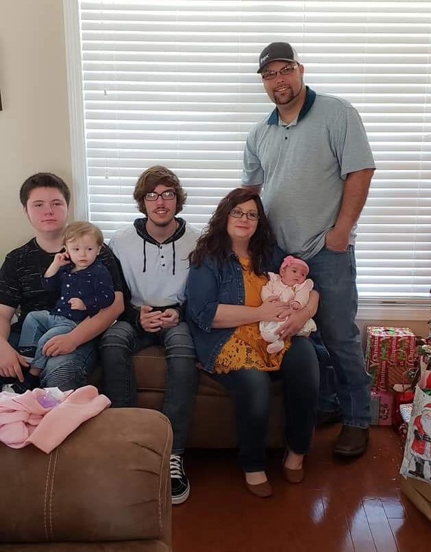Michael Branam's family (from left): Brendan (holding Lane), Zach, Crystal and Emma are his blessings.