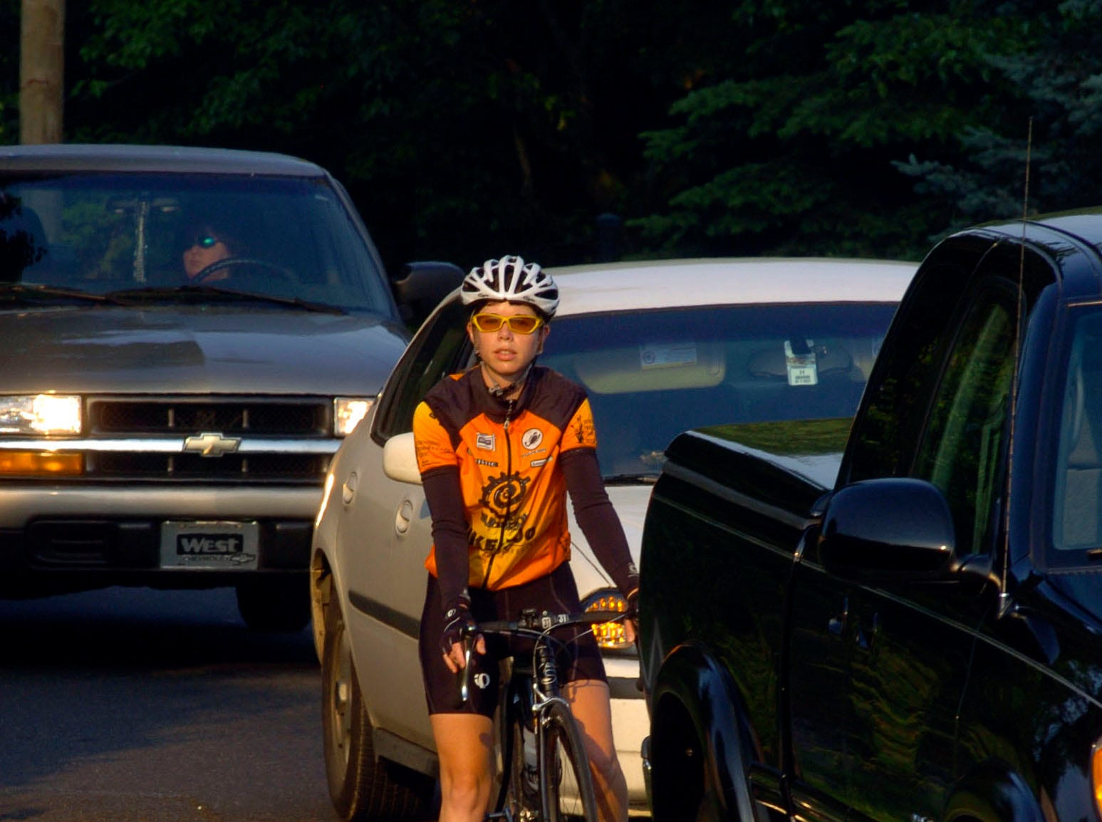 Laura Devlin waits in traffic at the traffic light on Maryville Highway 441 and Chapman Highway for Bike-to-work week in May 2005.
