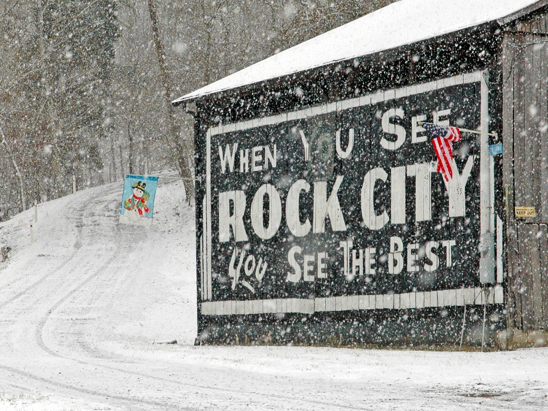 "An Americana classic is seen through the snow last week on Chapman Highway near Sevierville in 2008. It is one of hundreds of barns emblazoned since 1935 with advertising for the Lookout Mountain attraction according to Rock City spokeswoman Karen Baker. ""We're still painting them but it's harder because of highway ordinances. Barn advertising is governed the same as billboards,"" she said. According to Baker, here are currently about 90 Rock City barns in the Southeast and most  are the handiwork of Chattanooga sign painter Jerry Cannon. The National Weather Service forecast for Knoxville and vicinity calls for a 70% chance of snow Saturday with accumulations of up to 2 inches."