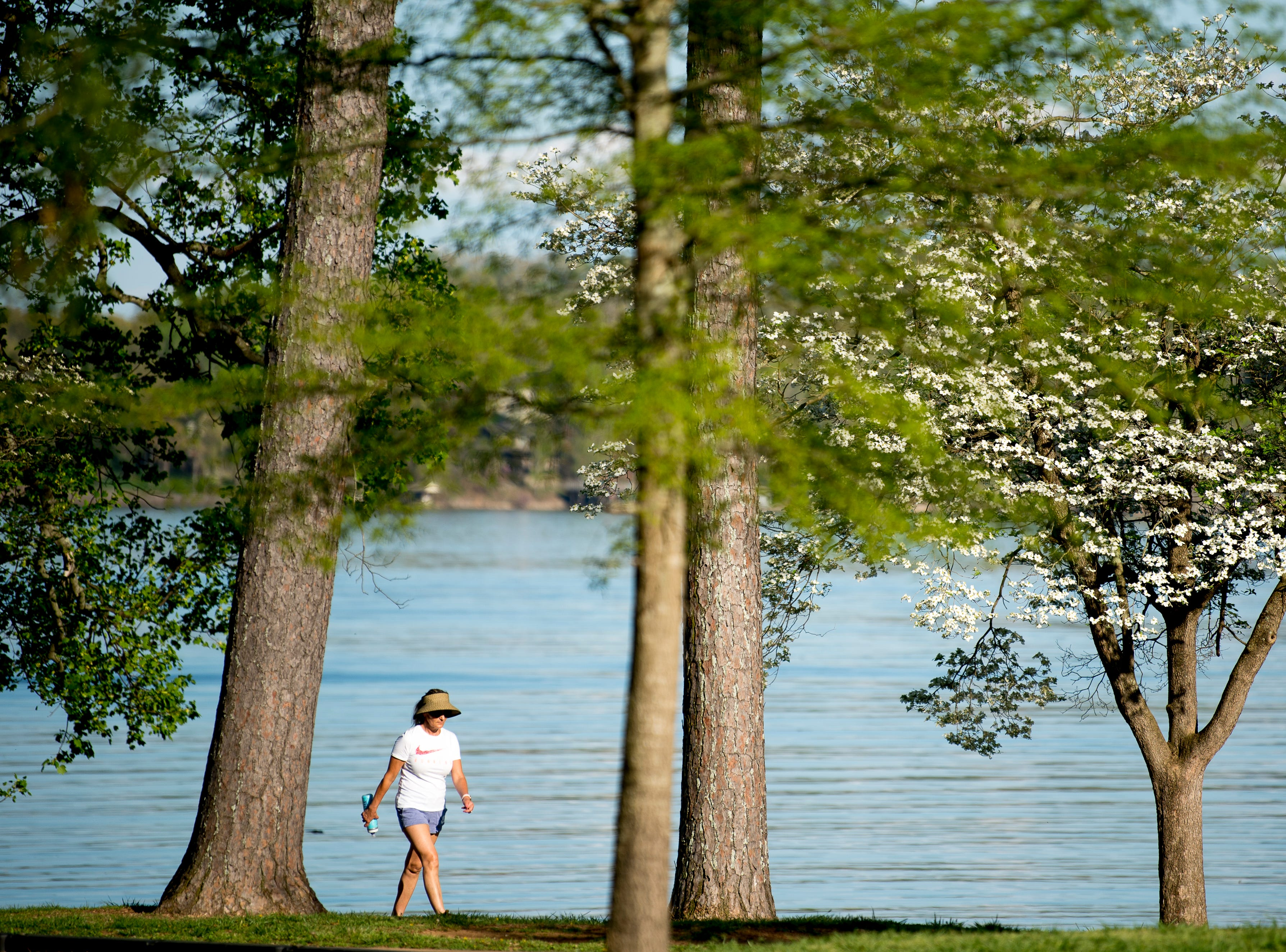 A woman walks through The Cove at Concord Park in Knoxville on Wednesday, April 10, 2019.