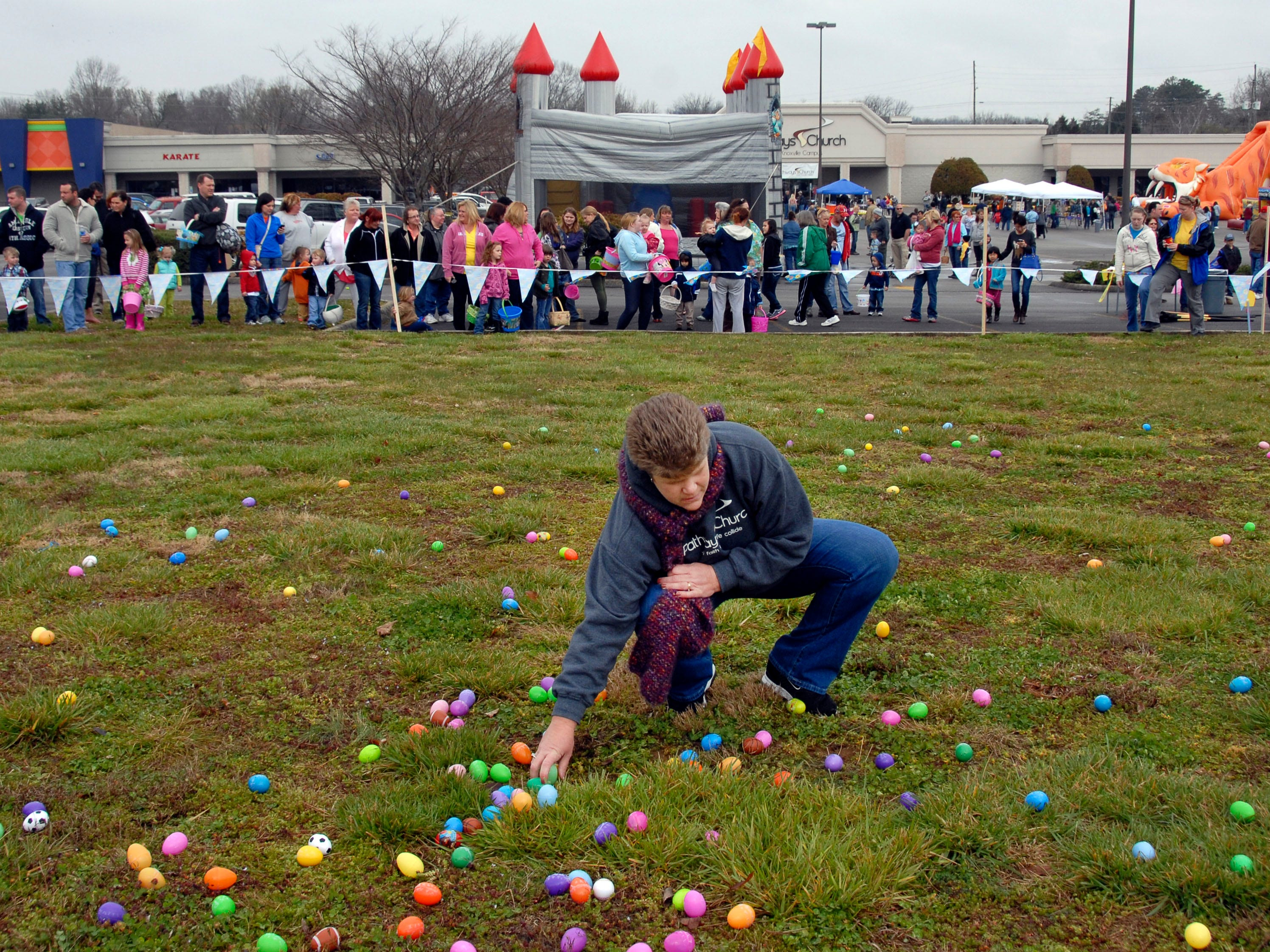 Patty Harmon, a member of Pathways Church, helps spread Easter eggs prior to the hunt during the Easter EGGstravaganza at the Pathways Church South Knoxville campus on Chapman Highway Saturday, March 30, 2013. Church members stuffed 15,000 plastic eggs for the event -- kicking off the opening of the new church, which will hold its first worship service Sunday, March 31. It is located in the old WalMart off Chapman Highway.