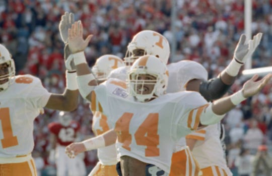 University of Tennessee running back Chuck Webb (44) celebrates after scoring a 79-yard touchdown in the Cotton Bowl against Arkansas, Jan. 2, 1990, in Dallas. Tennessee won, 31-27, and Webb was the offensive player of the game. Webb shared SEC all-freshman team honors with gifted receiver and dual threat Carl Pickens, who had a team-high four interceptions in only four games at free safety. Pickens scored that season by interception return, kick return and reception. The Vols went 11-1 and reached a No. 8 ranking. (AP Photo/IK)