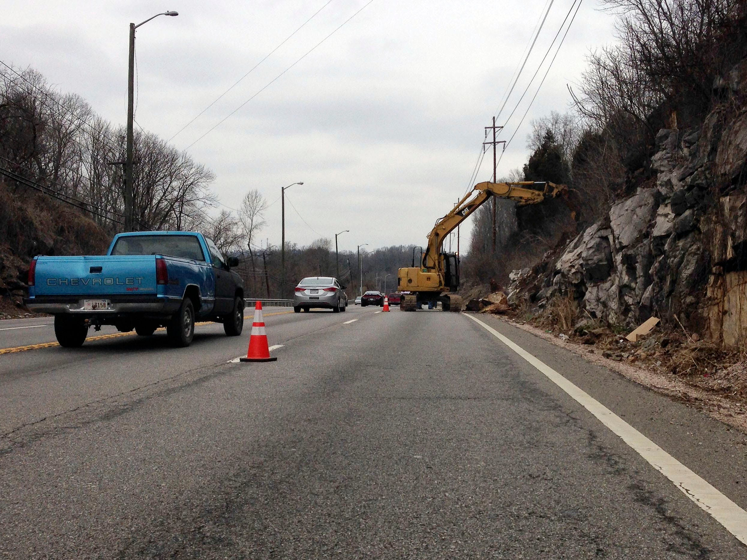 TDOT crews began work to remove loose rocks from a section of hillside along Chapman Highway around 10 a.m. Thursday. One lane on the northbound side was closed near Ye Olde Steakhouse on Feb. 2, 2014.