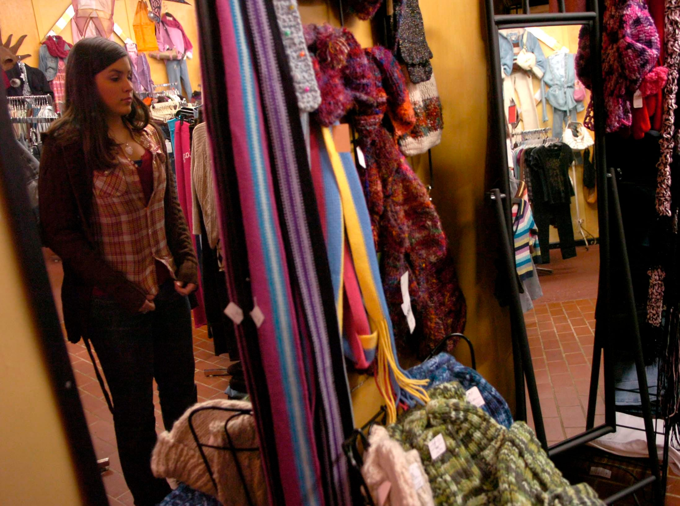 Sara Foley of Knoxville shops at Sally's Alley clothing store on Chapman Highway in 2006.