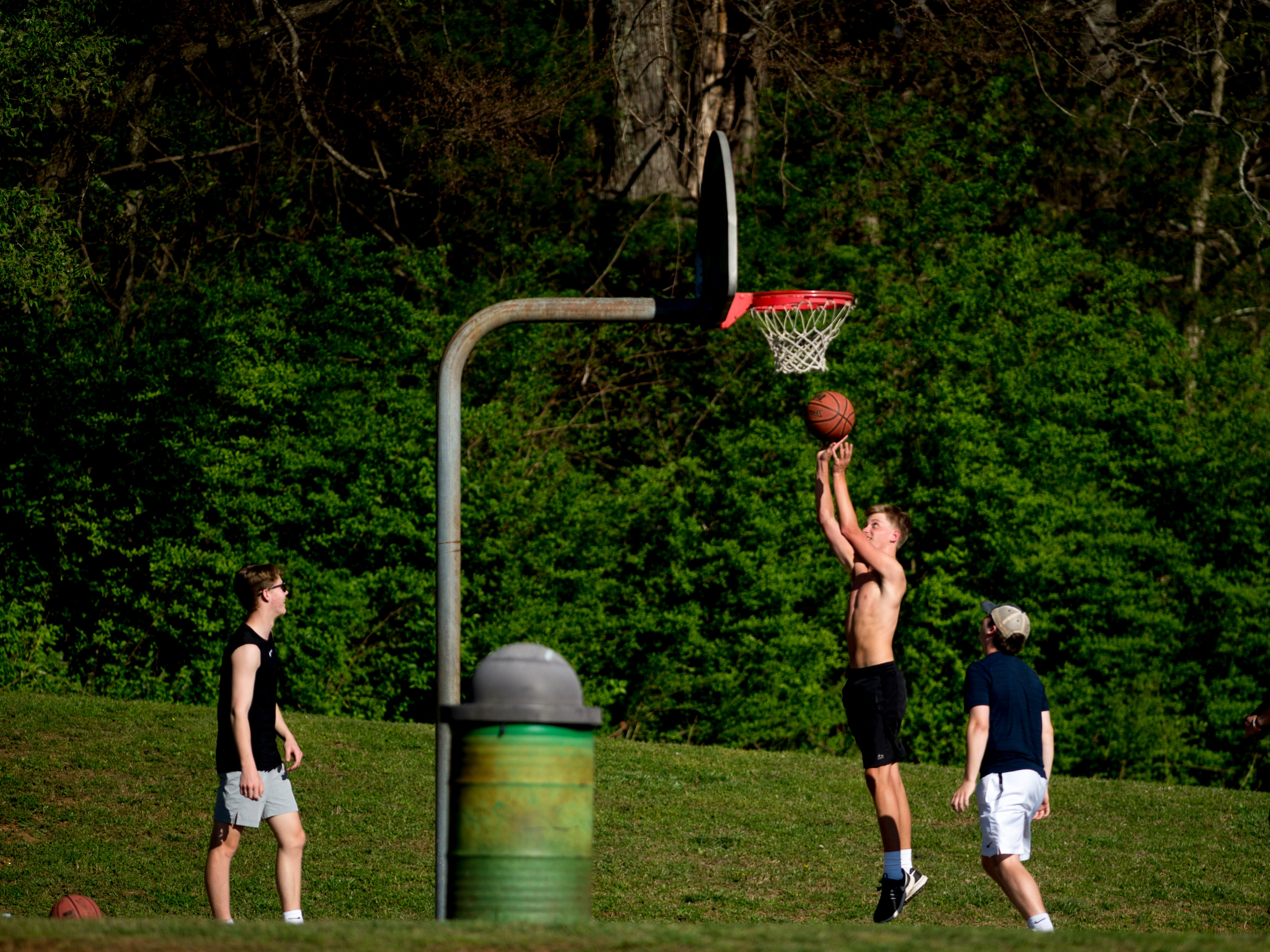 Kids play basketball at Carl Cowan Park in Knoxville, Tennessee on Wednesday, April 10, 2019.