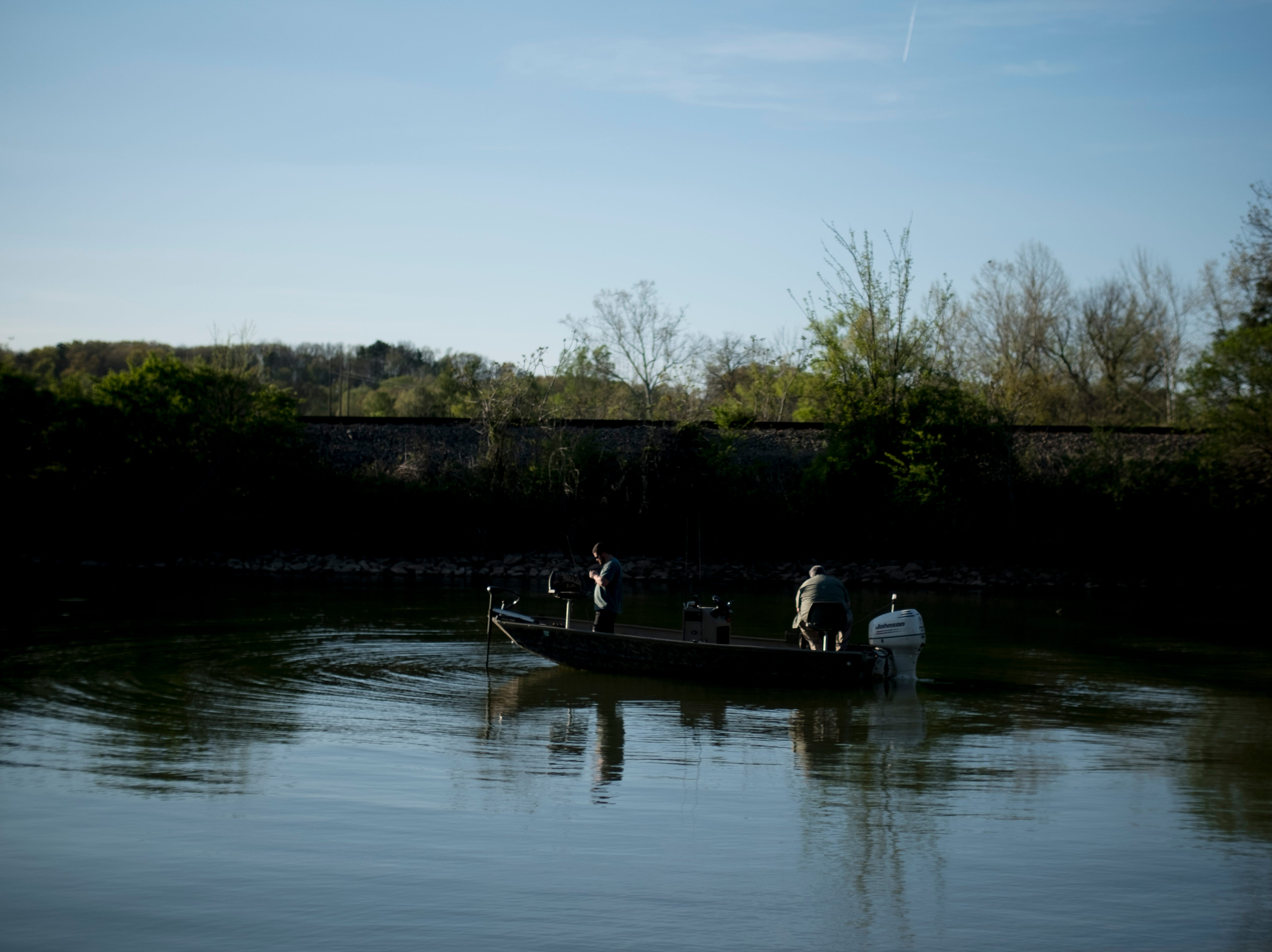 Fishermen float past Concord Park in Farragut, Tennessee on Wednesday, April 10, 2019.