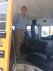 Bus duty is a time for executive director Kelly Hayman to hand out high-fives and smiles to each kid.