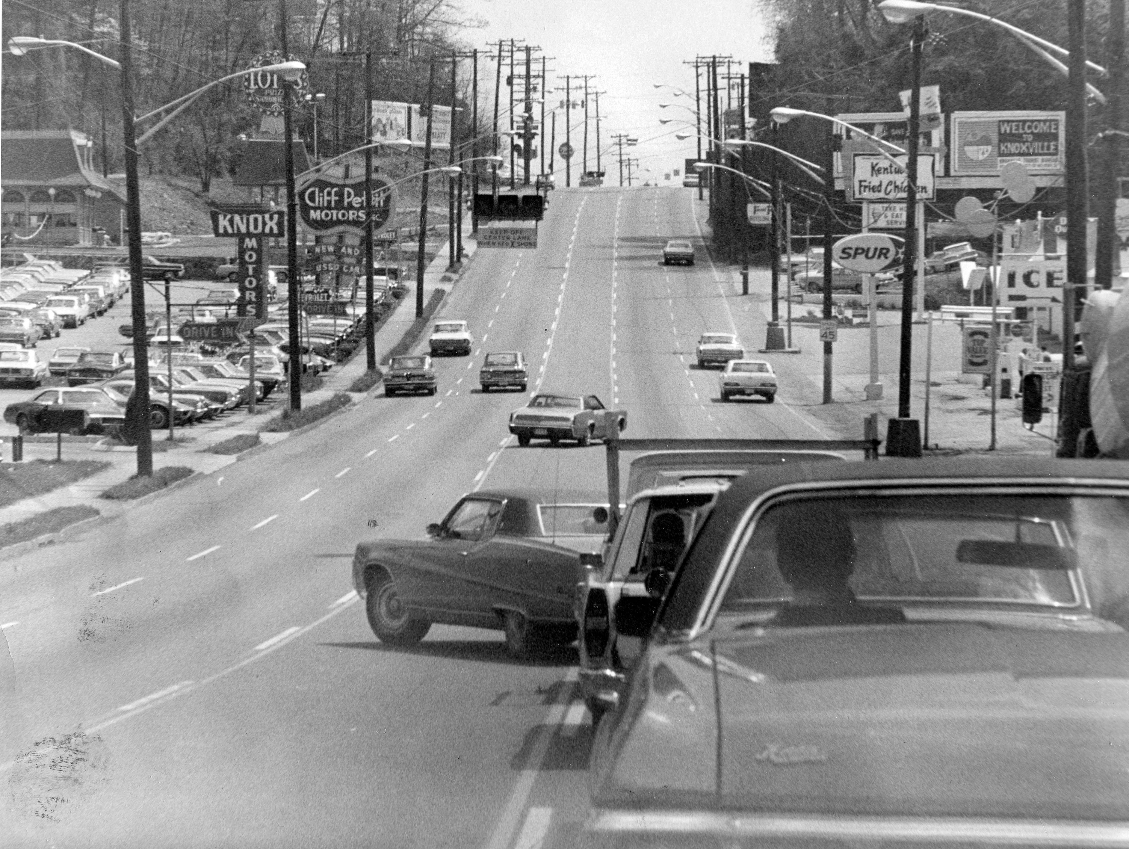 "Chapman Highway in 1970. According to the caption, ""The center lane on Chapman Highway is for motorist making left turns from 9 a.m. to 3 p.m. and from 6 p.m. to 6 a.m., but this motorist chose to make a left turn from the inside southbound through lane. This forced through traffic to slow to a virtual stop and created the danger of collision on the busy highway. The center lane is for inbound traffic 6 to 9 a.m. and for outbound traffic 3 to 6 p.m."