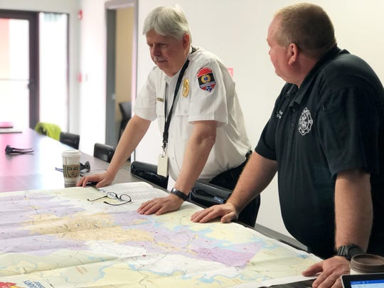 """It's apparent how much growth there has been in this part of the county,"" said Rural Metro Fire Chief Jerry Harnish, pictured left with Captain Eric Knoefel, noting the location of neighboring Stations 31 and 30 on a map. The new fire station aims to provide the best possible service while maintaining the best response times."