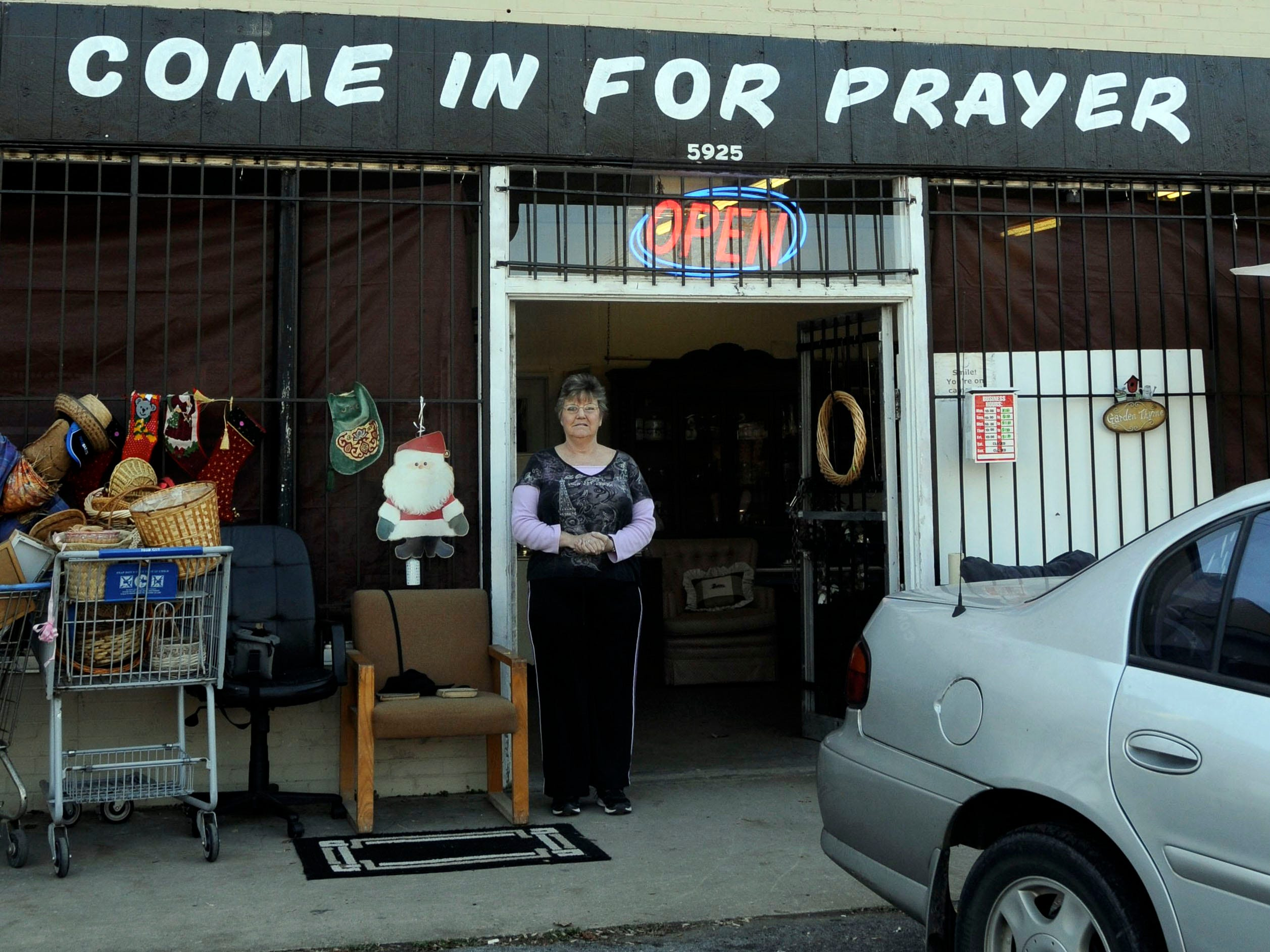 Vicki Johnson welcomes anyone who wants prayer to come into God's Place Thrift Store on Chapman Highway. 2012.