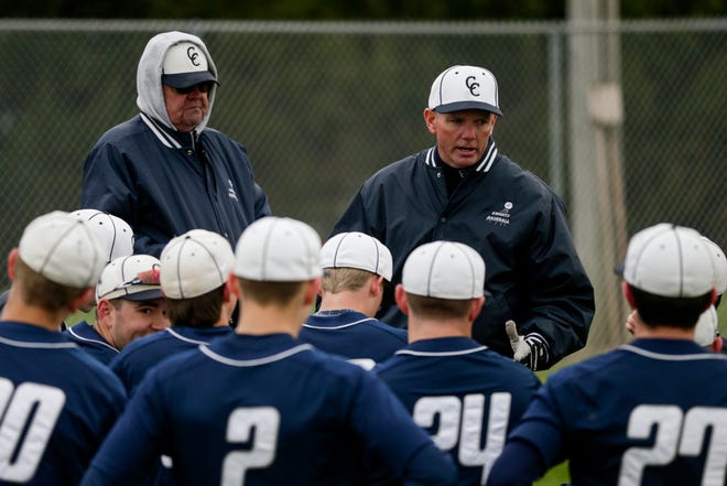 Central Catholic head coach Tim Bordenet talks with the players after defeating Benton Central, 4-1, Wednesday, April 10, 2019, at Benton Central High School in Oxford.