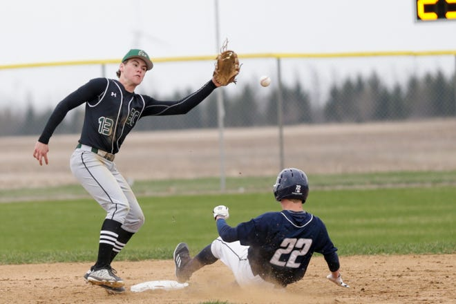 Central Catholic left fielder Scott Lovell (22) slides into second as Benton Central short stop Alex Thurston (13) misses the pass during the third inning of a high school baseball game, Wednesday, April 10, 2019, at Benton Central High School in Oxford. Central Catholic won, 4-1.