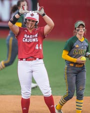 UL's Kourtney Gremillion makes a 3-run double as the Ragin' Cajuns play the Southeastern Louisiana Lions at Lamson Park Wednesday, April 10, 2019.