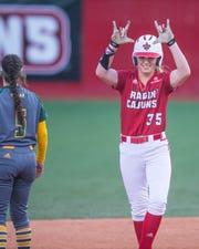 UL's Sarah Hudek celebrates a double to score two runs as the Ragin' Cajuns play the Southeastern Louisiana Lions at Lamson Park Wednesday, April 10, 2019.
