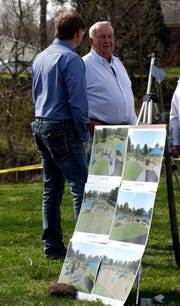 Bill Bainter, right, talks to Mike Tharp Jr., Lancaster Parks and Recreation superintendent, after the ceremonial ground breaking for an all-access playground at Hunter Park. Bainter, the brother of former parks and recreation superintendent Don Bainter, donated $80,000 to install the playground.