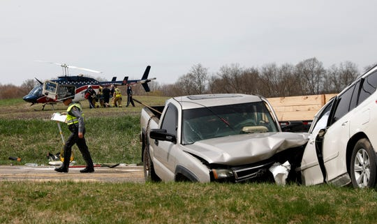 Firefighters and medical helicopter flight crew members carry a patient to a waiting helicopter Thursday afternoon, April 11, 2019, on Lake Road in Pleasant Township. One person was flown to Ohio State University Wexner Medical Center and won was taken to Fairfield Medical Center after a head on crash involving two crashes.