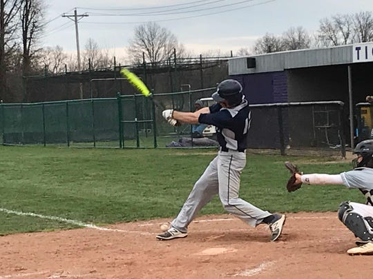 Lancaster junior Casey Finck hits the ball off his foot during the Golden Gales' 7-5 win over Pickerington Central on Wednesday.