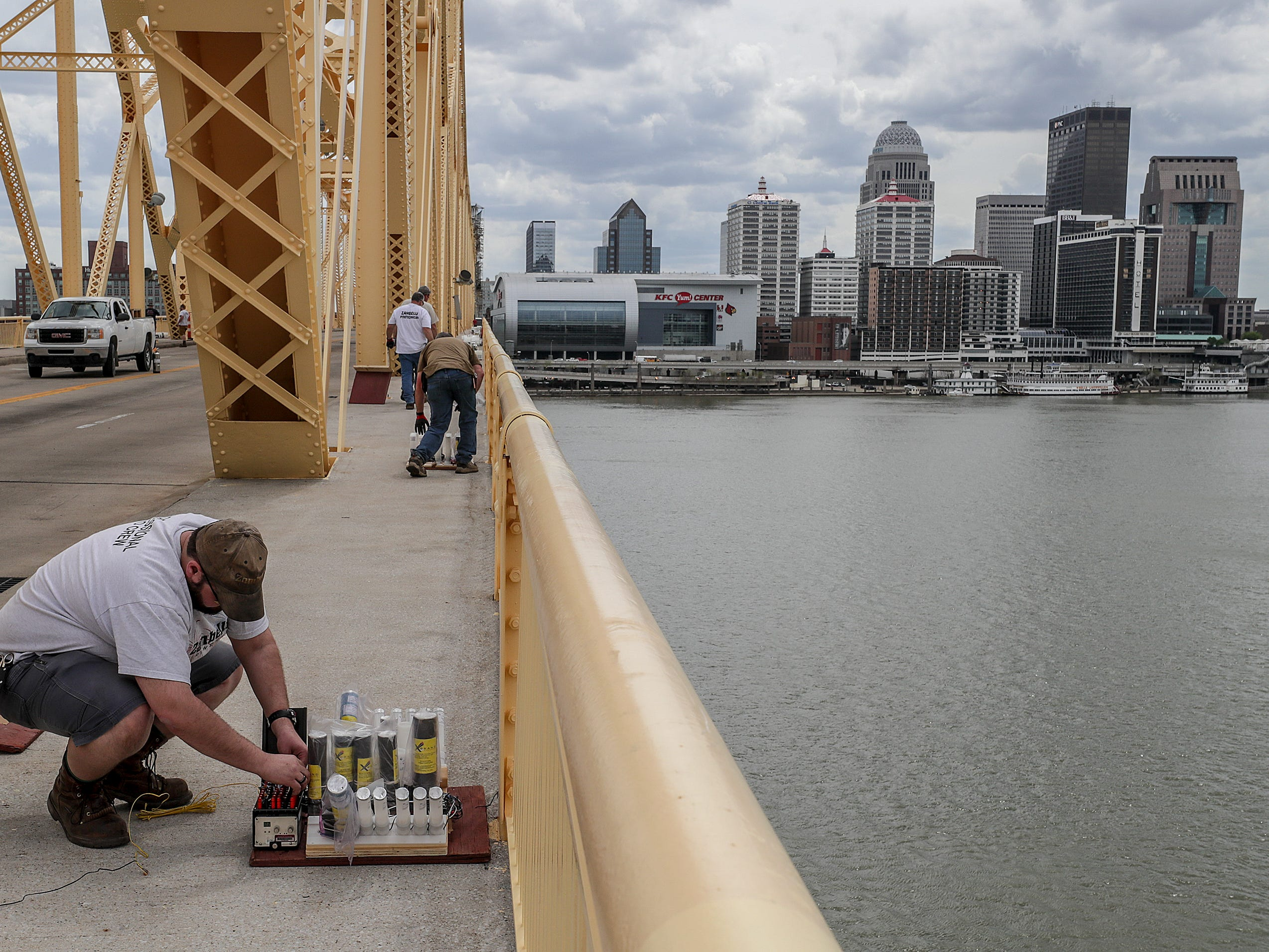 Ben Back, with Zambelli, helps secure the fireworks to the Clark Memorial Bridge on Thursday afternoon as crews took over the bridge in advance of Thunder Over Louisville.