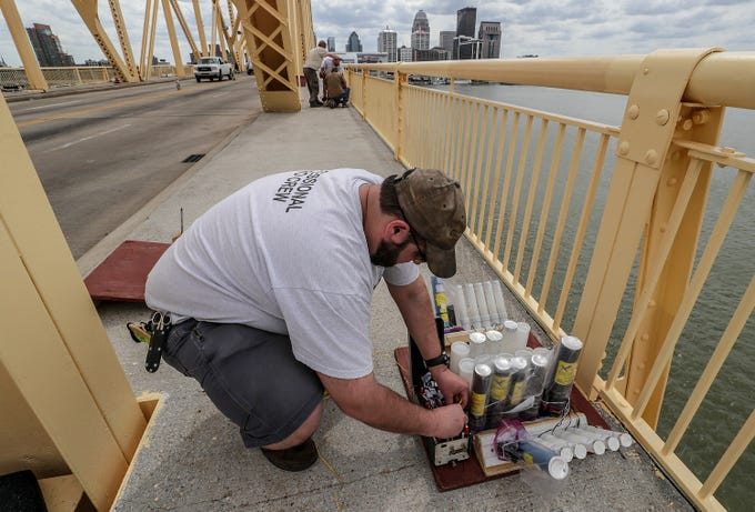 Ben Back, with Zambelli, helps secure the fireworks to the Clark Memorial Bridge on Thursday afternoon as crews took over the bridge in advance of Thunder Over Louisville.April 11, 2019