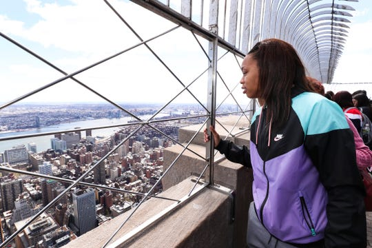 Louisville star Asia Durr admires the view from the Empire State Building hours before the WNBA Draft.